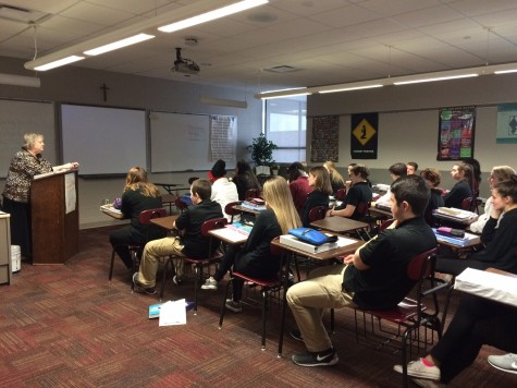 Religion teacher Kathleen Dautremont teaches a class of sophomores.