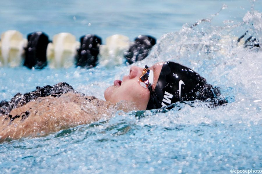Senior Mary Martin swim the backstroke leg of the 200 medley relay. Photo by Chris Pose.