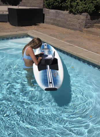 Anna Gipple (12) attends online school from the pool