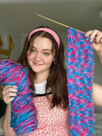 Senior Sarah Wicker poses with her in-progress knitted bag.