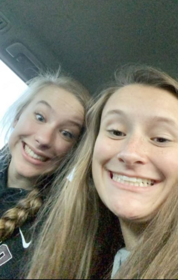 Kate Easter (11) and Anna Heitzman (11) pose for a quick selfie after school