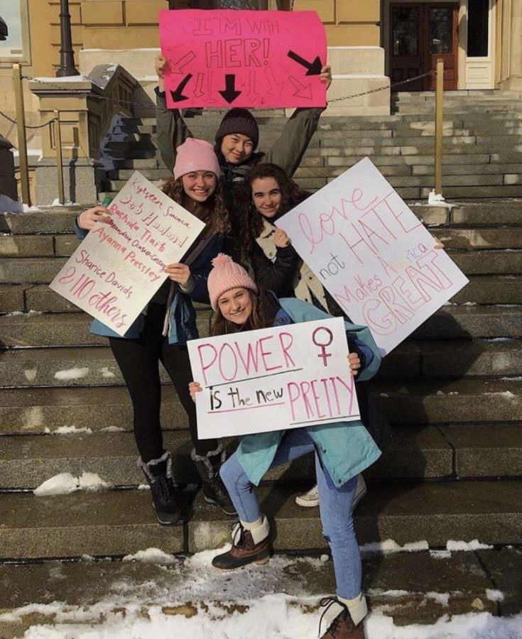 Feminist Club members Riley O'Halloran (12), Lele Nigg (12), Rachel Heaston (12), and Theresa Tran (12), attend the 2019 Des Moines Women's March