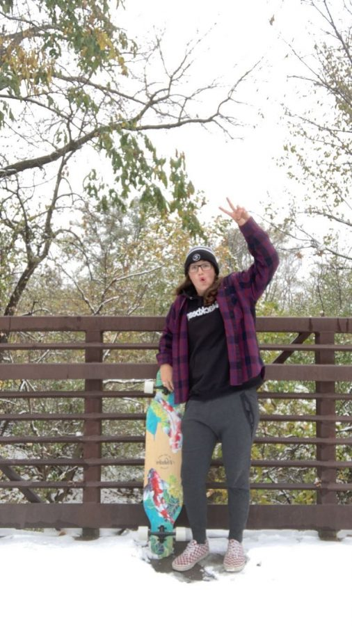 Cece Villa (12) combines skateboarding with snowboarding on her snowy day off.