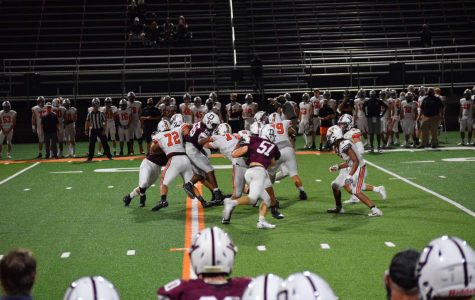 Dowling Catholic Maroons play vigorously against the competition.