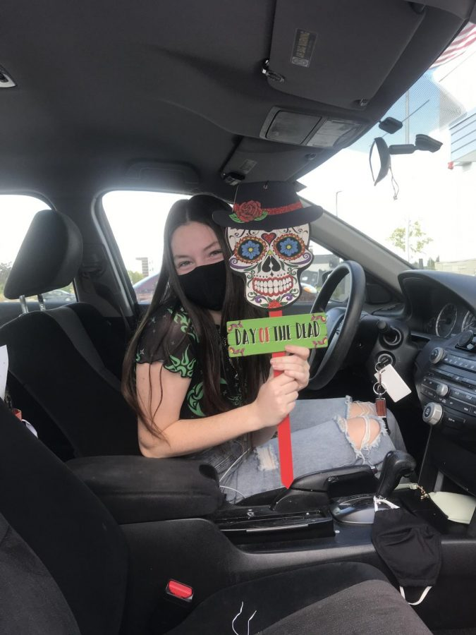 Jane Koerner (11) showing off her new Halloween car decoration