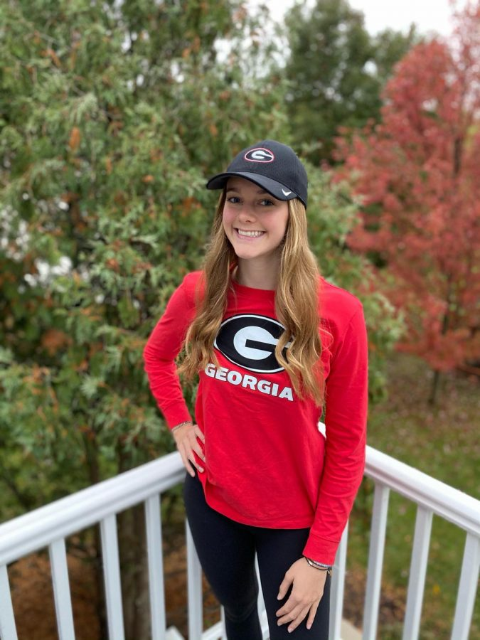Mary Martin dressed in the University of Georgia gear where she is planning on attending to swim next year.