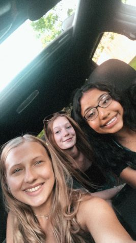 Kaylee Tigner with friends driving around listening to music last summer