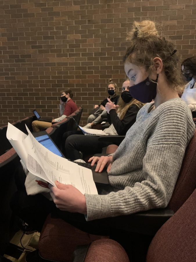 Olivia Spraklin (11) looks over the senior course packet and plans out her last classes at Dowling.