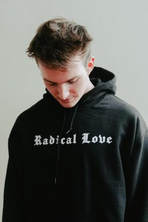 Dylan Smidt (12) modeling his clothing  brand, Radical Love, now available for purchasing.