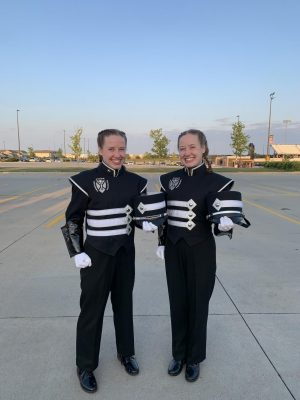 Colleen Cain (left) and Kate Cain (right) pose before leading the band during their first competition of the season. They had a great performance and were excited to finally kick off the marching season.