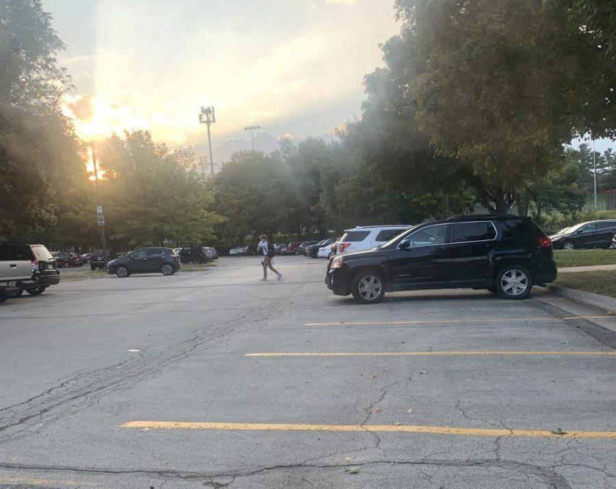 Cars begin to park in the lot before 7:30 a.m. Early risers arrive to save spots for friends and talk to teachers.
