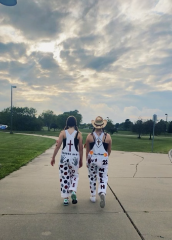 Seniors Mary Kate Melcher and Maggie Carlson showing off their overalls